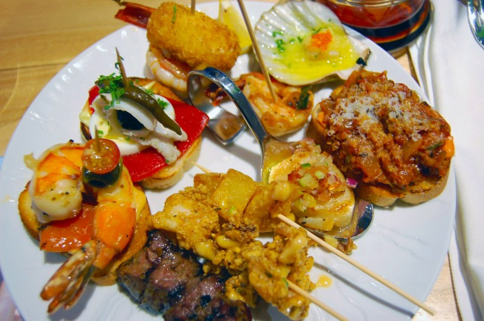 Tapas at Tomar, ROUND 1: scallops, carne de vaca skewers, brochetta, patatas bravas, chopitos con ali oli, gambas galore, and croqueta. FIGHT!